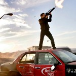 Ethan Hunt Shooting On Taxi Wallpaper